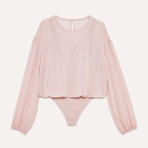 Blush bodysuit by Wilfred